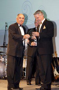 Hon Terry Waldron MLA presents the Hospitality Industry Lifetime Achievement Award to Neil Randall