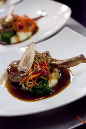 Main Course - Linley Valley pork chop on creamy mash potato, bacon and pistachio relish, broccolini and topped pear cider jus
